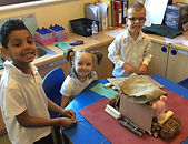 year 1 materials workshop children making a 3 little pigs house