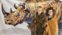 pupils dressing up as stone age people in our primary school workshop
