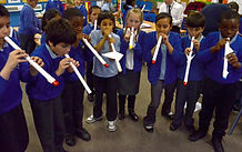 pupils making rockets in a science workshop