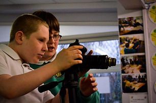 boys using a camera in our key stage 1 and 2 victorian primary school workshop