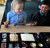 year 4 pupils handling roman artefacts f
