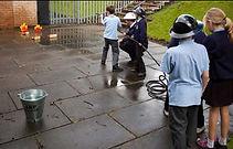 WWII school workshop stirrup pump task