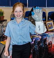wearing a glove signed by Buzz Aldrin.JP