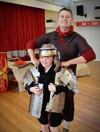 boy trying on roman armour in a primary history workshop