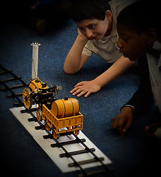 boys using a steam train in our key stage 1 and 2 victorians primary school workshop