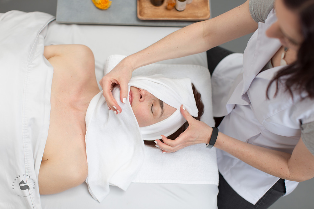 Client at Freddy Fox Face Total Skincare receiving an exfoliating organic chemical peel