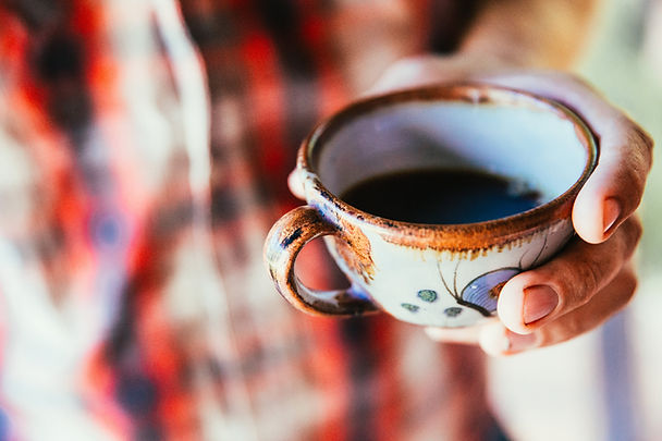 ceramic-coffee-cup-in-hand.jpg