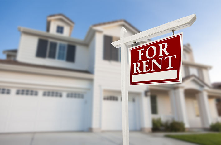 Red For Rent Real Estate Sign in Front of Beautiful House..jpg