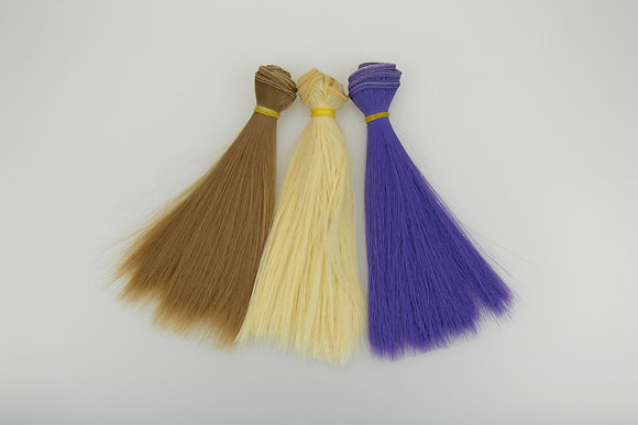 Hair tresses for dolls are straight. Set of 3