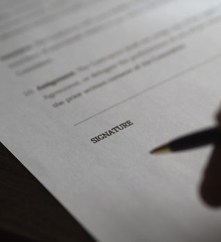 canva-person-holding-pen-near-white-prin