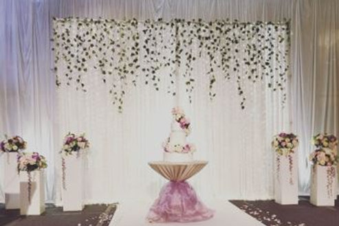 White Fabric Backdrop with Artificial Flower