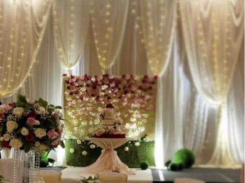 White Fabric Backdrop with Artificial Flower Wall