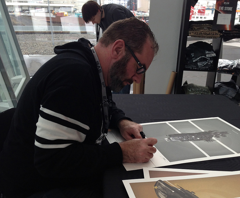 Signing my illustration posters at the Harpa in Reykjavik, Iceland