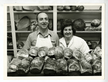 One of the Perlmutars and a Perlmutar baker in the bakery. OJA, fonds 107, series 1.