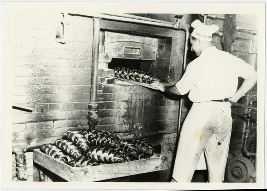 Baker working at Crown Bakery after Max Hartsone and Ben Richman acquired the business, 319 Augusta Ave., ca. 1947. OJA, accession 2017-10-5.