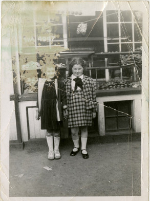 Two girls in front of Lottman's Bakery at its 172 Baldwin St. location, ca. 1930s. OJA, accession 2013-11-2.
