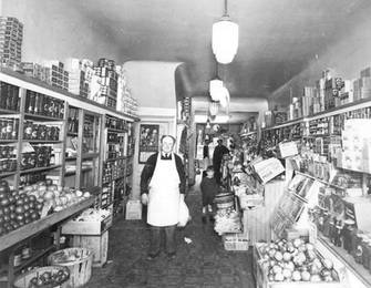 Joseph Gary (front) in his grocery at 420 College Street, ca. 1935. OJA, item 1544.