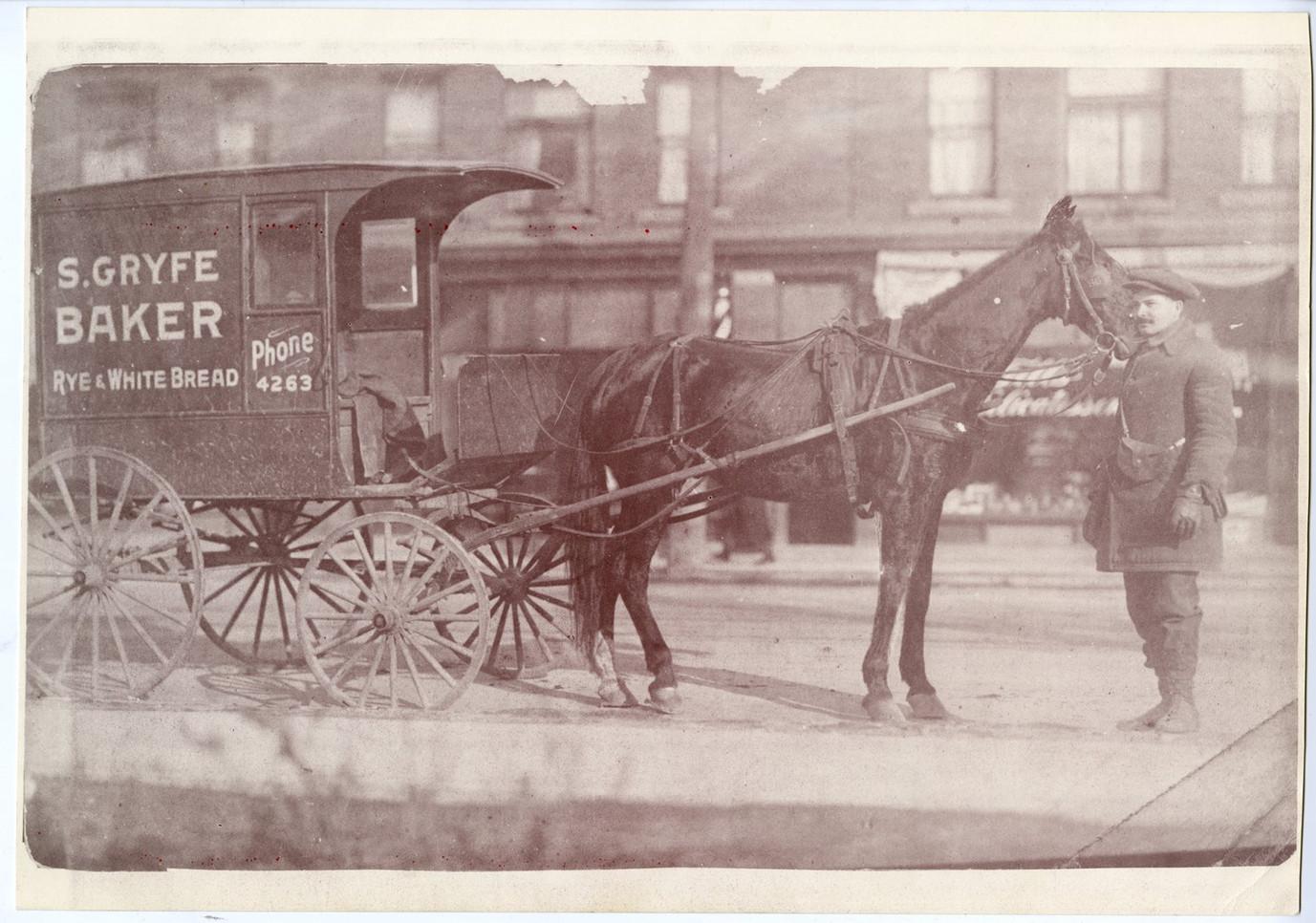 Sam Gryfe with his horse-drawn bakery wagon in Hamilton, Ontario, ca. 1915. OJA, item 6025.