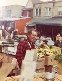 Joseph Fremar at his fruit store, ca. 1970s. Fremar Family Collection.