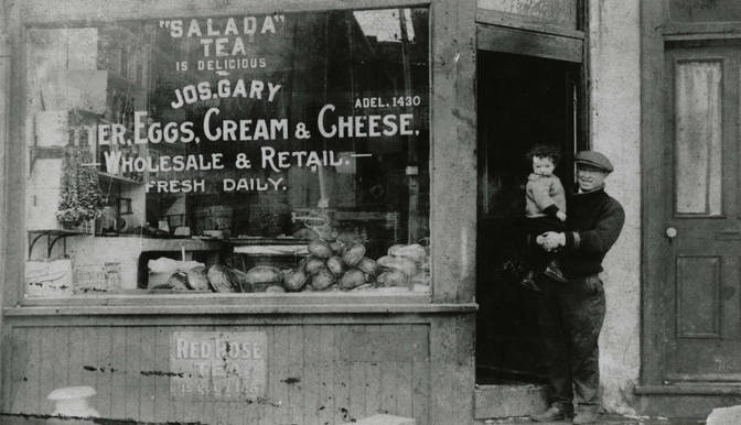 Joseph Gary in front of his grocery at 136 Elizabeth Street in St. John's Ward, ca. 1925. OJA, item 1542.