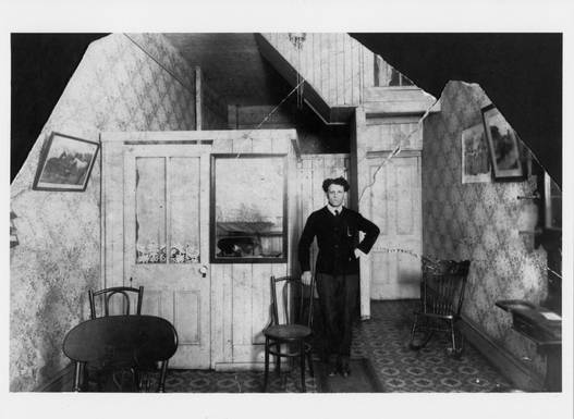 Jacob Sprachman in the King St. E. location of his shop, ca. 1908. OJA, item 3288.