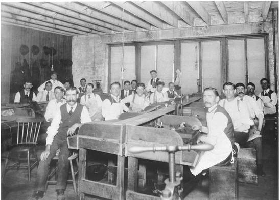 Employees in the workshop of a cigar factory in Montreal, including Abraham Walerstein, far left. ca. 1908-1909. OJA, item 1921.