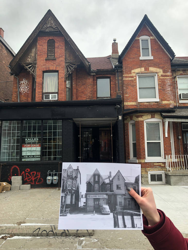 One of the curators holds a photograph of Tasty Bagel Bakery in front of 33 Kensington Avenue. Photo credit: Amy Intrator.