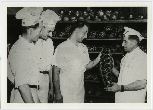 Group of bakers at Crown Bread Company after Max Hartsone and Ben Richman acquired the business, 319 Augusta Ave., ca. 1947. OJA, accession 2017-10-5.