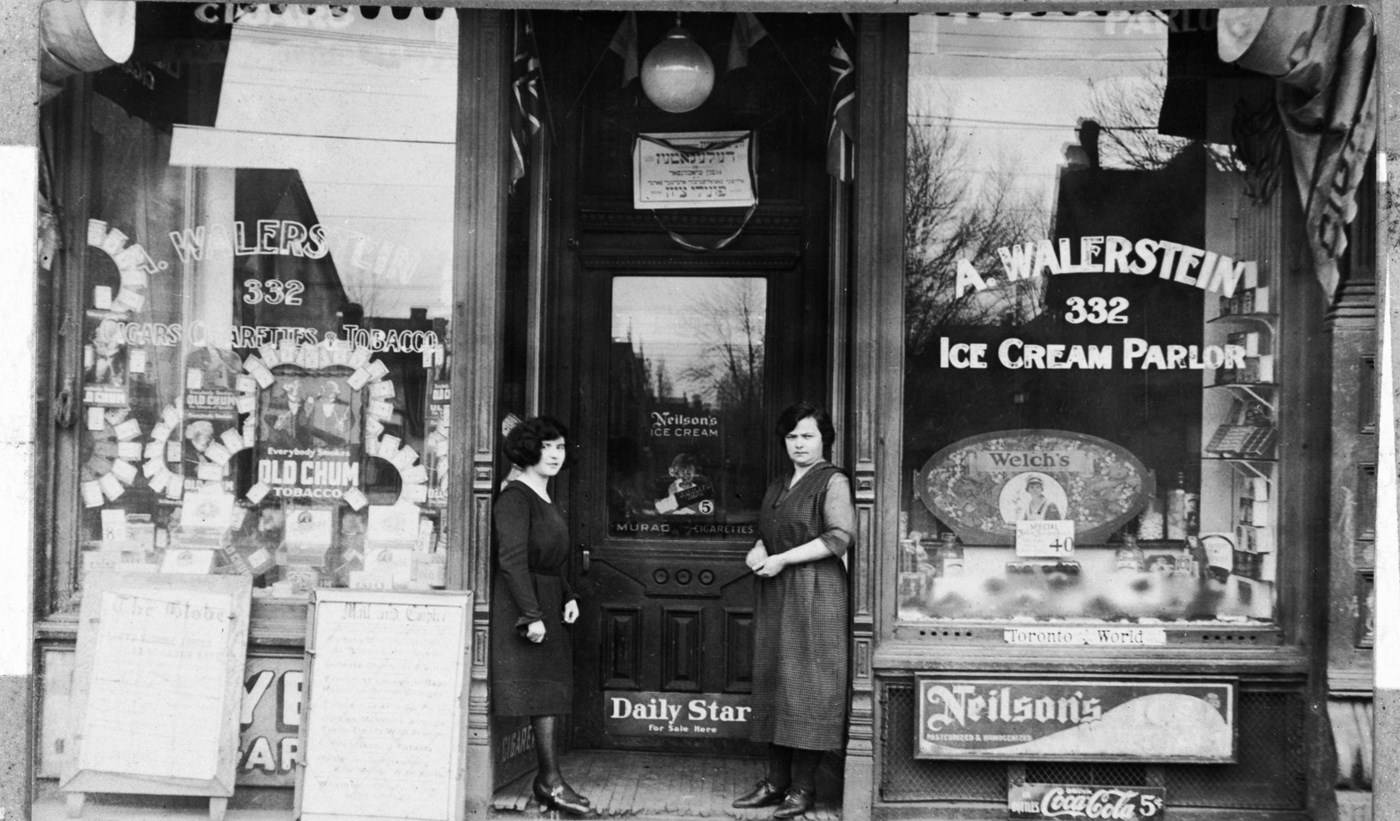 Sarah Walerstein (left) and her mother Taube Walerstein (right) in front of Walerstein's Ice Cream Parlour, ca. 1922-1923. OJA, item 2534.