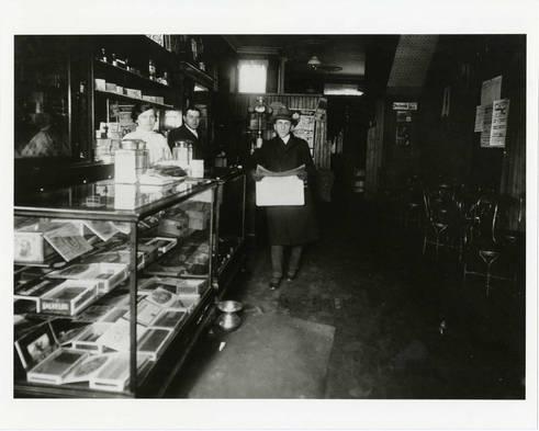 Taube Walerstein, Abraham Walerstein, and Ben Zion Hyman (left to right) inside Walerstein's Ice Cream Parlour, ca. 1917-1918.