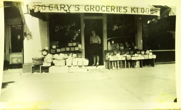 Shirley Gary standing at entrance to Gary's Groceries, ca. 1940s. Halter Family collection.