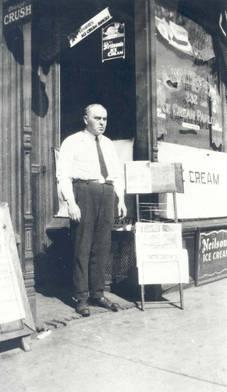 Abraham Walerstein in front of Walerstein's Ice Cream Parlour, ca. 1915-1926. OJA, item 2536.