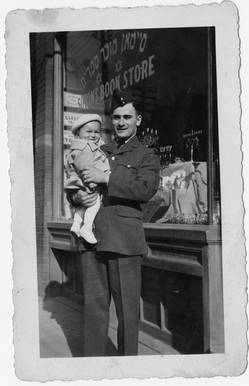 George Simon with nephew Fred in front of Simon's Book Store, ca. 1941. OJA, fonds 44, item 3.