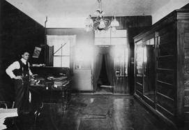 Jacob Sprachman in back of his store at its King St. E. location, ca. 1908. OJA, item 3429.