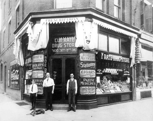 Sylvester James (right) in front of E.E. Rutherford's Cut Rate Drug Store, 400 Spadina Avenue, 1910. OJA, item 3663.