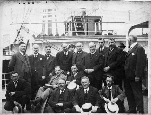 Group of steamship agents on board a ship, including Henry Dworkin (back left), ca. 1920. OJA, item 6083.