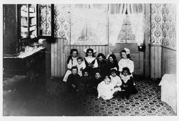 Third birthday party in back of Sprachman Tailor Shop at its King St. E. location, ca. 1900-1910. OJA, item 3430.