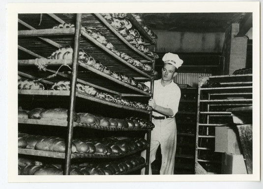 Man working in Crown Bread Company after Max Hartsone and Ben Richman acquired the business, 319 Augusta Ave., ca.1947. OJA, accession 2017-10-5.