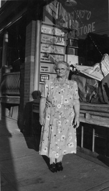 Etta Simon in front of Simon's Book Store, 549 Dundas Street W., ca. 1940. OJA, fonds 44, item 4.