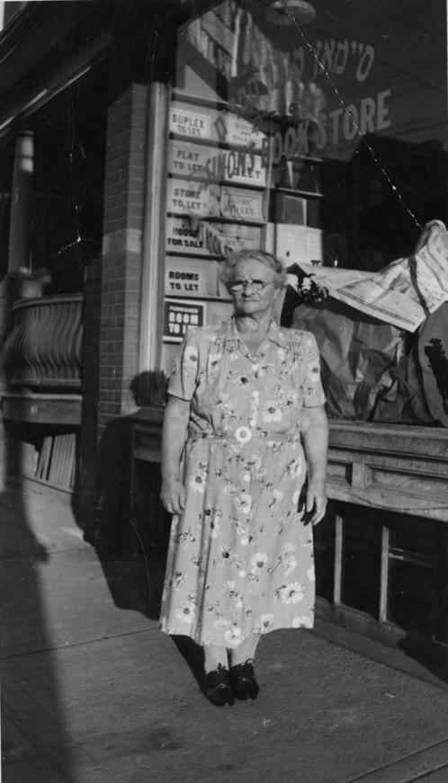 Etta Simon in front of Simon's Book Store, 549 Dundas Street W., ca. 1940. OJA, fonds 44, item 4.