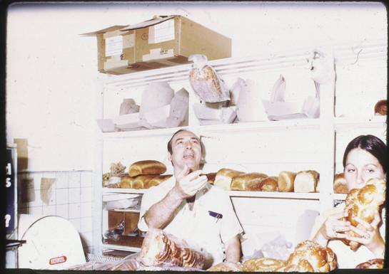 """Morris """"Moishe"""" Perlmutar tossing bread inside the bakery. OJA, item 277."""