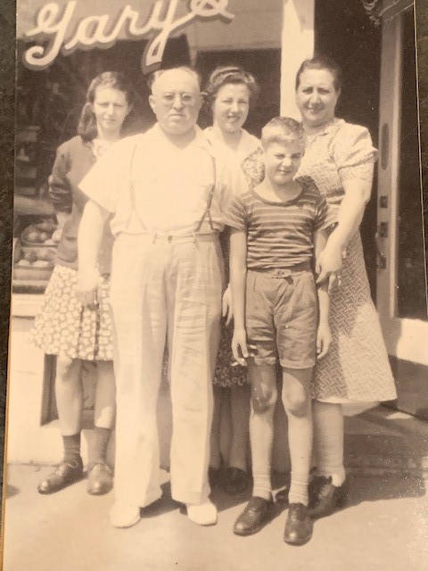 Gary family outside storefront, ca. 1940s Standing left, Ethel, Joseph, Shirley, Leslie and Goldie. Halter Family collection.