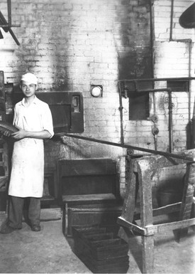 Arthur Gryfe in front of Gryfe Bakery oven, 319 Augusta Ave, ca. 1931. OJA, item 4519.