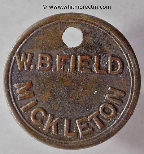 Mickleton (Glos?) 26mm W. B. Field Uniface. Brass with off-centre hole.