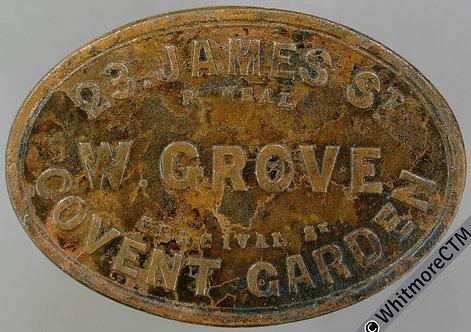 Market Token Covent Garden 36x25mm One shilling W.Grove  23 James St. Oval brass