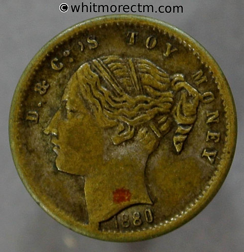 Toy Coin. D & Co. Young Head Shilling 445 13mm 1880 - Brass