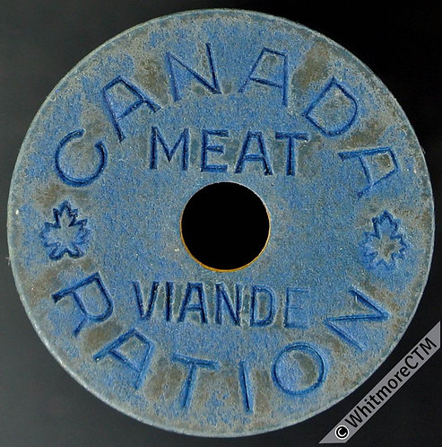 Canada WWII Meat Ration Token. 22mm blue fibre with central hole.