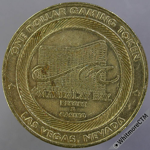 USA Las Vegas One Dollar Gaming Token 37mm Mandalay Bay Resort. Brass