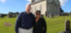 John & Lori in gveyd of Ballymore CofI church.jpg