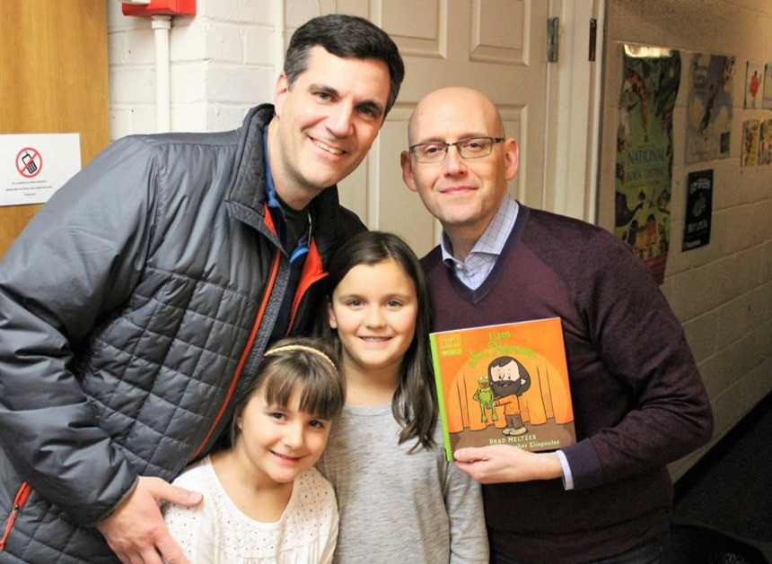 """Daddying blog editor Scott Beller with his daughters and Brad Meltzer holding book """"I Am Jim Henson"""""""